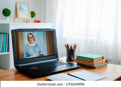a female teacher gives a lecture at an online course webinar Distance learning online education. A home distance learning.