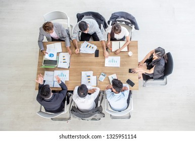Female team leader or businesswoman ceo in suit presenting new project discussing corporate plan at multiracial team meeting in boardroom, business coach mentor teaching employees at company training