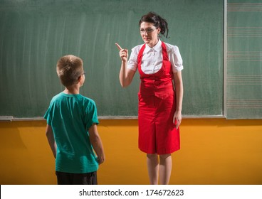 female techer looking  to her student with severe attitude