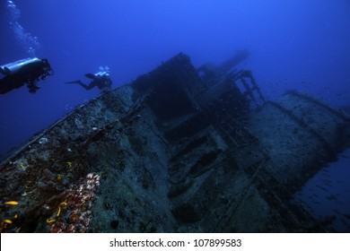 Female technical divers exploring the underwater shipwreck Eagle in the Florida Keys off of Islamorada just south of Key Largo.