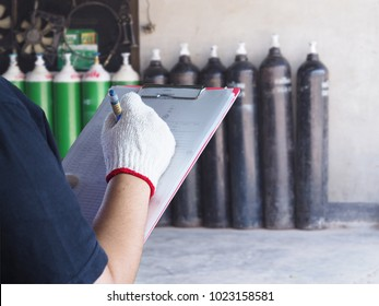 Female technician check Oxygen tank industry