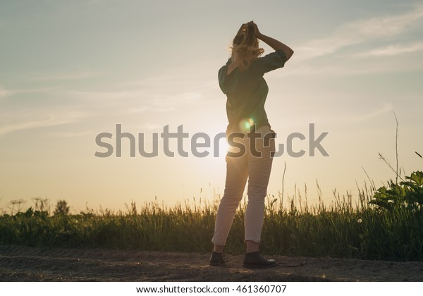 female teen girl stand in the fields copy space for your info