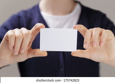 female teen hands holding business card, selective focus