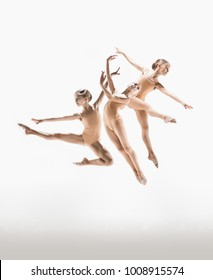 The female teen modern ballet dancer jumping on white studio background. Collage with one model