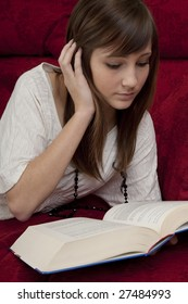 female teenager reads book