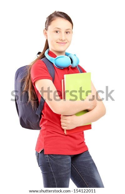 Female teenager with schoolbag and headphones holding notebooks, isolated on white background