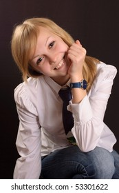 Female teenager wearing a white shirt and a tie