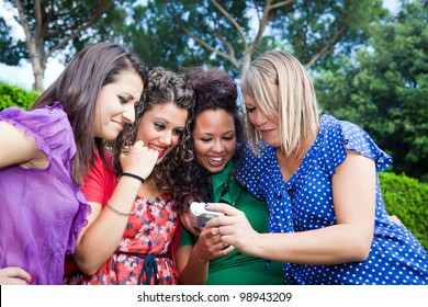 Female Teenagers Looking Photos in the Camera