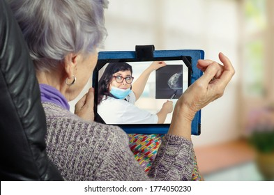 Female telemedicine doctor explains the benefits and risks of breast cancer screening among older women during a remote appointment