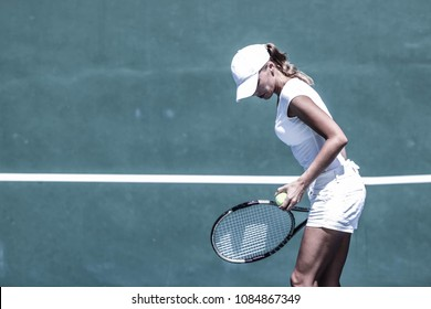 Female tennis player on court ready to hit