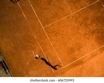 Female tennis player on the court. Wide angle view from above with plenty of copyspace