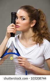 Female tennis player with racket