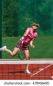 Female tennis player serving