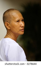 A female Thai monk dressed in white.