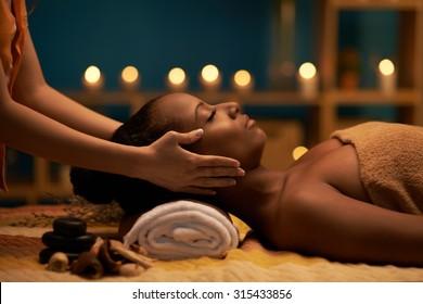 Female therapist doing professional rejuvenating face massage