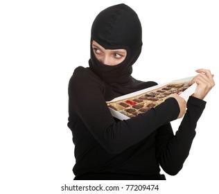 female thief with in black balacalava box of chocolates