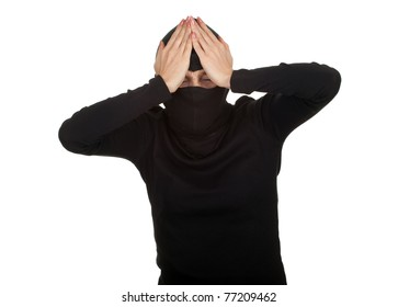 female thief in black clothes and balaclava with hands on head