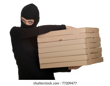 female thief in black clothes and balaclava with boxes of pizza