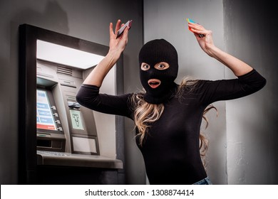 female thief robs an ATM