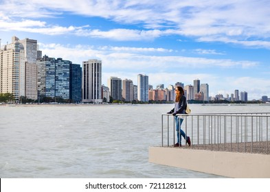 Female tourist admiring Chicago cityscape from the viewpoint