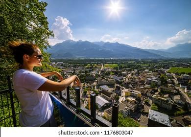 Female tourist admiring view of Vaduz, Liechtenstein. Vaduz is the capital of Liechtenstein and also the seat of the national parliament.