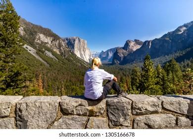 Female tourist enjoying the view in Yosemite National Park