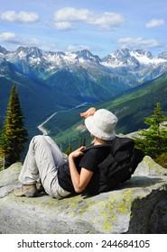 Female tourist at Glacier Crest Trail in Glacier National Park, British Columbia, Canada