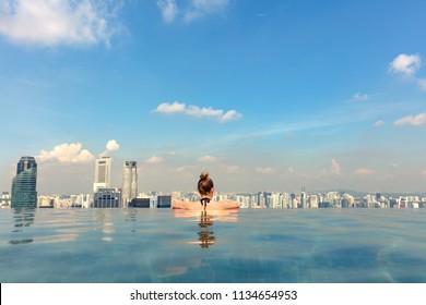 Female Tourist In Infinity Pool Of Marina Bay Singapore