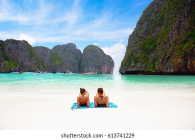 Female tourist laying at Phi Phi Maya Bay in the summer of Krabi, Thailand