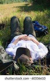 Female tourist taking nap in a field