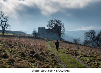 Female tourist walking Crichton Castle, a 14th century fortification in Midlothian, South of Edinburgh, Scotland, UK