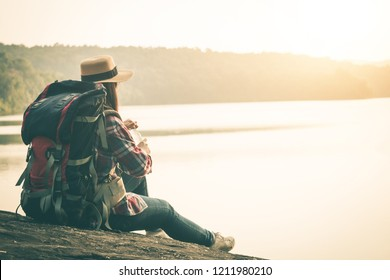 Female tourists in beautiful nature in tranquil scene, Tourists backpack go to nature.
