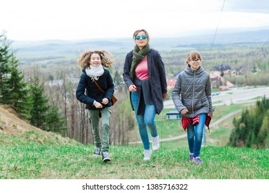 Female tourists reaching top - still having a lot of energy