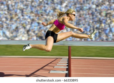 Female track and field athlete hurdling.