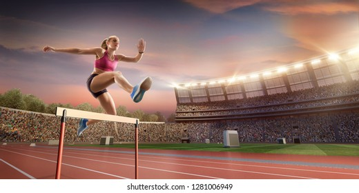 Female Track and field athlete jumps over the barrier at the running track in professional stadium