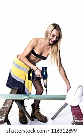 Female tradesman carpenter in lingerie