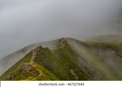 Female trailrunning in the foggy mountains of Lechtal Alps, North Tyrol, Austria