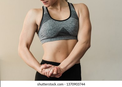 Female trainer showing her arm muscels. Healthy, active lifestyle, losing weight. Women power