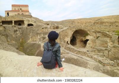 Female Traveler Admiring the Uplistsikhe Cave City Ruins, Located Near Gori Town in Shida Kartli Region, Archaeological site in Georgia - Shutterstock ID 1583282224