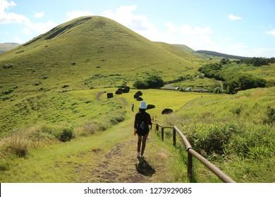 Female Traveler Exploring Puna Pau Crater, the Red Scoria Quarry for Moai Statues' Topknots Called Pukao, Easter Island of Chile