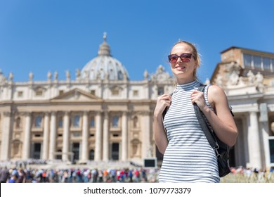 Female traveler on St. Peter's Square in Vatican in front of St. Peter's Basilica.