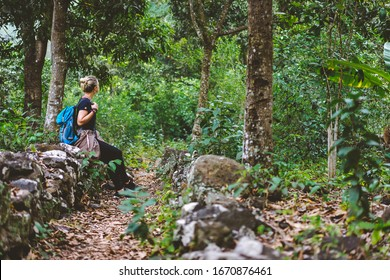Female traveler rest during hike in coffee plantation on Santo Antao Cape Verde