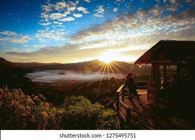 Female traveler in Rural Home in the North of Thailand with Beautiful Mountain View of Phu Langka National Park, Thailand