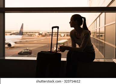 Female traveler waiting at the airport.