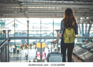 Female traveler waiting for take off flight in high ground at terminal airport. People and lifestyles concept. Business and travel theme.