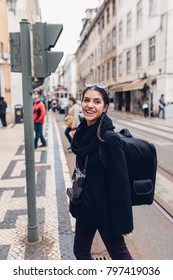 Female traveler woman sightseeing in European capital.Visitor in Lisbon,Portugal.Iconic tram route.Traveling Europe on a budget.Studying abroad.Photography and travel concept