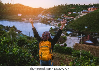 Female travelers travel nature mountain. Travel in trip Ban Rak Thai village in the countryside at Mae Hong Son, in Thailand.
