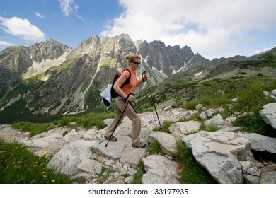 Female is trekking in Tatra Mountains. Trail to Rysy peak