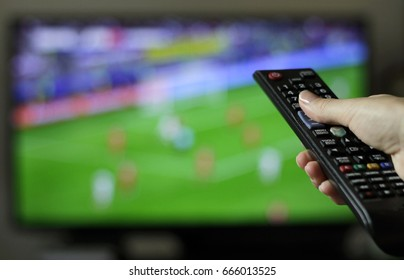 Female tuning into soccer game