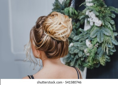 female upper high hairstyle for the wedding, unrecognizable rear view